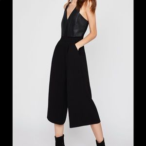 NWT BCBGeneration black jumpsuit with leather top
